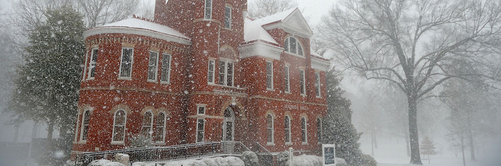a very snowy day in front of Ventress Hall